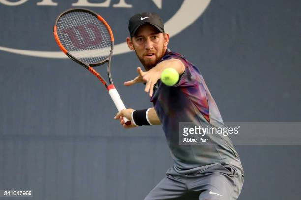 Dudi Sela of Israel returns a shot against Sam Querrey of the United States during their second round Men's Singles match on Day Three of the 2017 US...