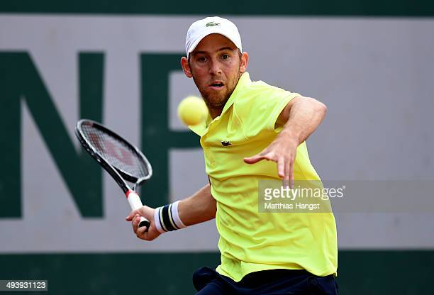 Dudi Sela of Israel returns a shot during his men's singles match against Donald Young of the United States on day two of the French Open at Roland...