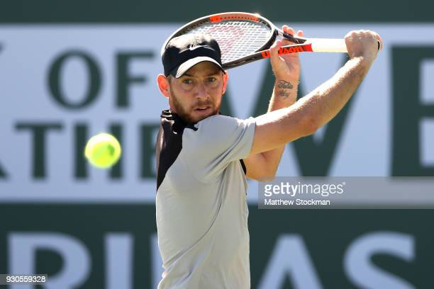 Dudi Sela of Israel returns a shot to Kyle Edmund of Great Britai during the BNP Paribas Open at the Indian Wells Tennis Garden on March 11 2018 in...