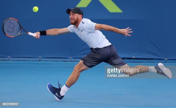 TOPSHOT Dudi Sela of Israel returns the ball to Spanish tennis player Fernando Verdasco during the first round of the ATP Qatar Open tennis...