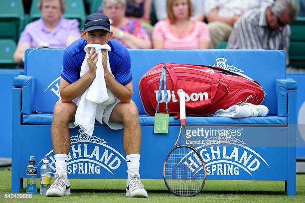 Dudi Sela of Israel sits on his bench between change of ends during his men's singles quarterfinal match match against Andres Seppi of Italy during...