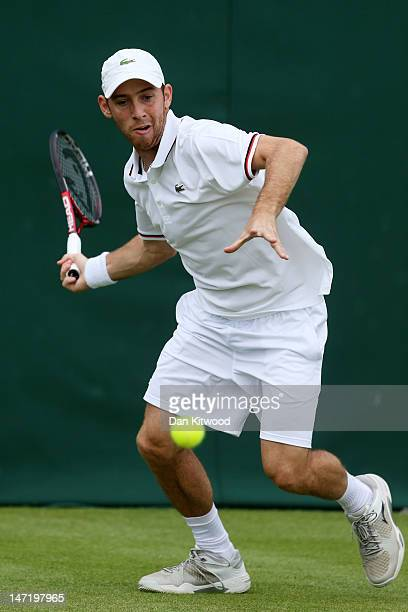 Dudi Sela of Israeleyes the ball ahead of his Gentlemen's Singles first round match against Ivo Karlovic of Croatia on day three of the Wimbledon...