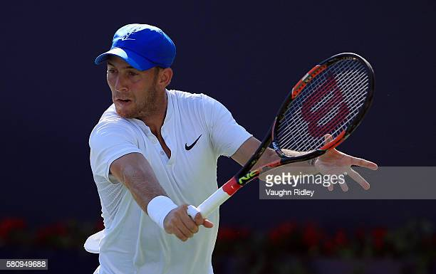 Dudi Sela of Isreal plays a shot against John Isner of the USA during Day 1 of the Rogers Cup at the Aviva Centre on July 25 2016 in Toronto Ontario...
