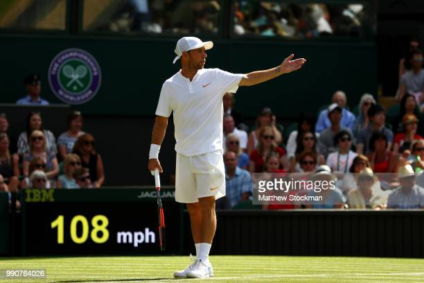 Dudi Sela of Isreal protests during his Men's Singles first round match against Rafael Nadal of Spain on day two of the Wimbledon Lawn Tennis...