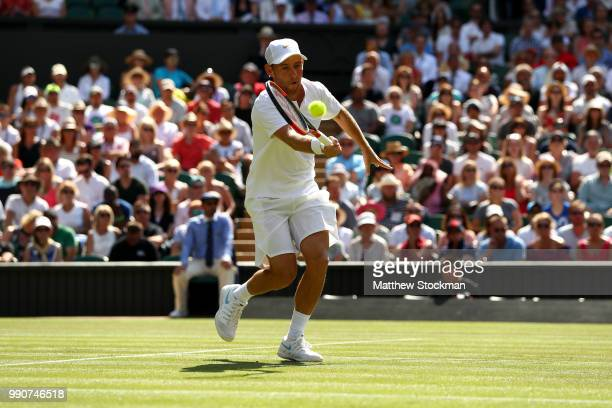 Dudi Sela of Isreal returns against Rafael Nadal of Spain during their Men's Singles first round match against on day two of the Wimbledon Lawn...