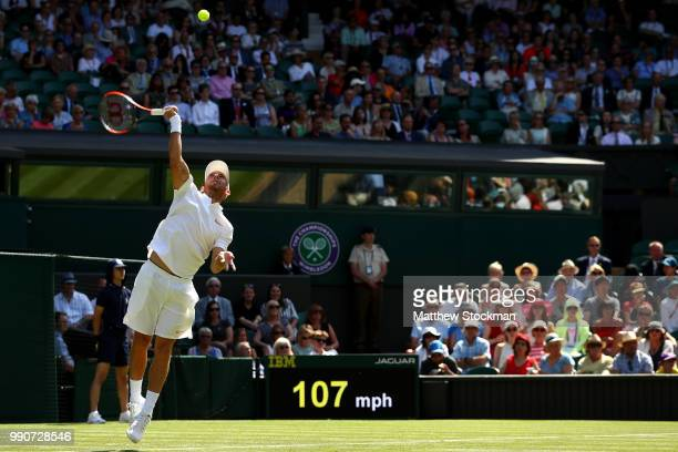 Dudi Sela of Isreal serves against Rafael Nadal of Spain during his Men's Singles first round match against on day two of the Wimbledon Lawn Tennis...