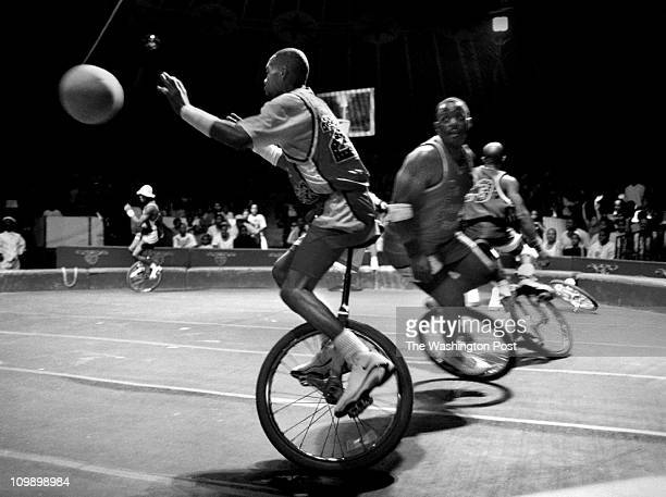 Dudley M Brooks BACKGROUND Perfomance of the UniverSOUL Circus Members of the King Charles Troupe perfom their high energy unicycle basketball act...