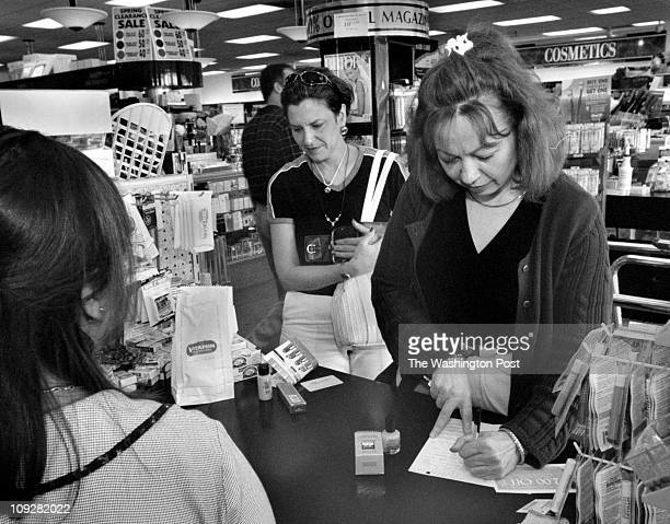 Dudley M. Brooks - Baileys Crossroads Shopping Center, Rt. 7 and Columbia Pike - Patricia Conroy signs up for a Loyalty Card at The Cosmetic Center...