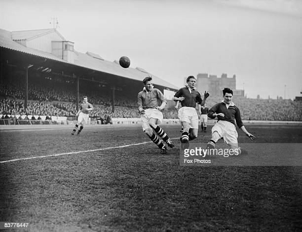 J Dudley of West Bromwich Albion in action with Derek Saunders and Ken Armstrong of Chelsea during a match at Stamford Bridge London 25th March 1954