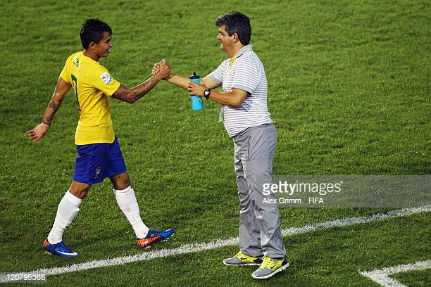 Dudu of Brazil celebrates his team's third goal with head coach Ney Franco during the FIFA U20 World Cup 2011 round of 16 match between Brazil and...