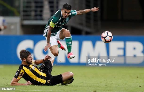 Dudu of Brazil's Palmeiras tries to control the ball next to Agustin Quintana of Uruguay's Penarol during Libertadores Cup match between Palmeiras...