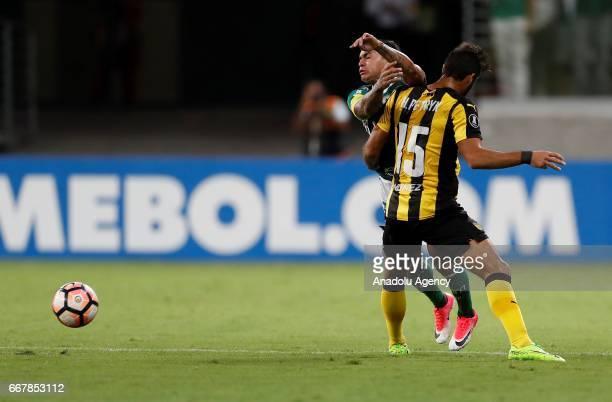 Dudu of Brazil's Palmeiras tries to control the ball next to Rodrigo Petrik of Uruguay's Penarol during Libertadores Cup match between Palmeiras and...