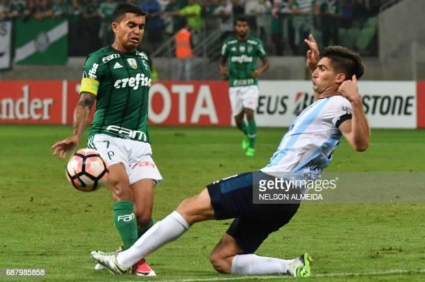 Dudu of Brazil's Palmeiras vies for the ball with Fernando Evangelista of Argentina's Atletico Tucuman during their 2017 Copa Libertadores football...