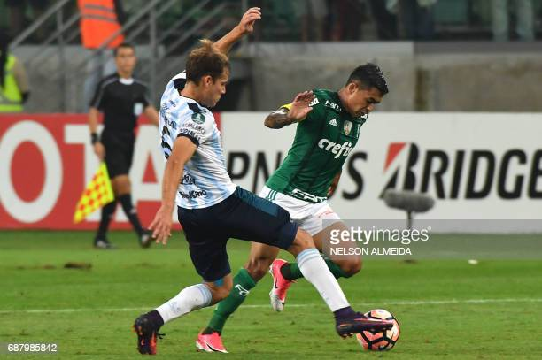 Dudu of Brazil's Palmeiras vies for the ball with Nery Leyes of Argentina's Atletico Tucuman during their 2017 Copa Libertadores football match held...