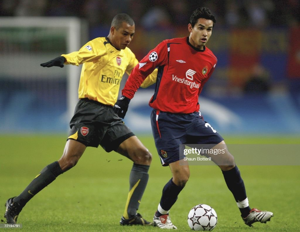 Dudu Of Cska Moscow Is Challenged By Gilberto R Of Arsenal During The Uefa