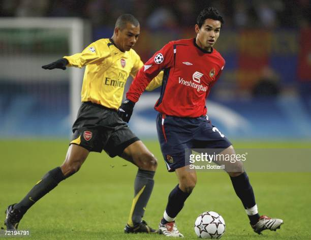 Dudu of CSKA Moscow is challenged by Gilberto of Arsenal during the UEFA Champions League Group G match between CSKA Moscow and Arsenal at Locomotiv...