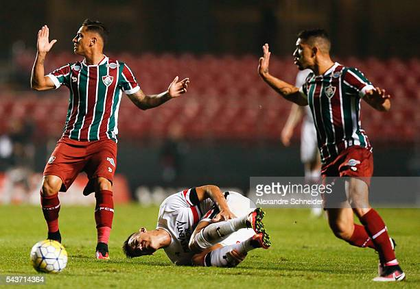 Dudu of Fluminense, Centurion of Sao Paulo and Douglas of Fluminense in action during the match between Sao Paulo and Fluminense for the Brazilian...