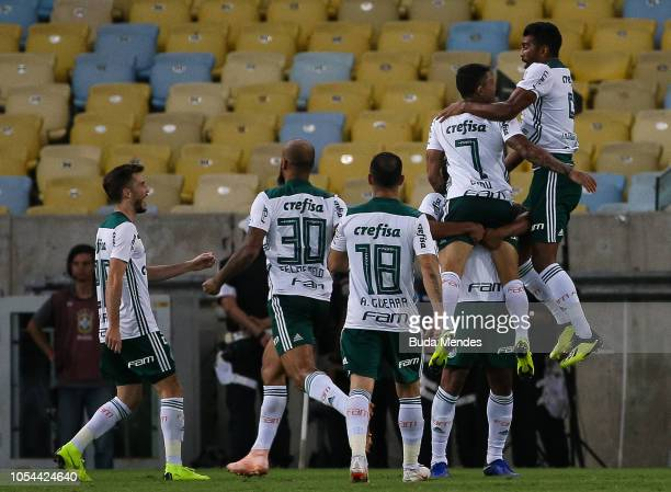 Dudu of Palmeiras celebrates a scored goal during a match between Flamengo and Palmeiras as part of Brasileirao Series A 2018 at Maracana Stadium on...