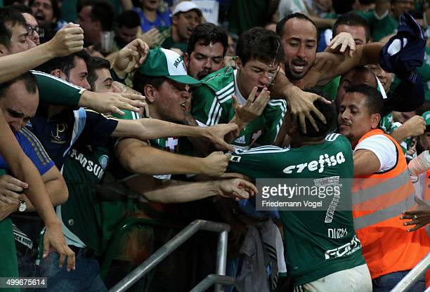 Dudu of Palmeiras celebrates scoring the second goal with fans of Palmeiras during the match between Palmeiras and Santos for the Copa do Brasil 2015...
