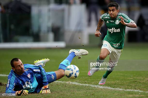 Dudu of Palmeiras fights for the ball with Diego Cavalieri of Fluminense during the match between Palmeiras and Fluminense for the Brazilian Series A...