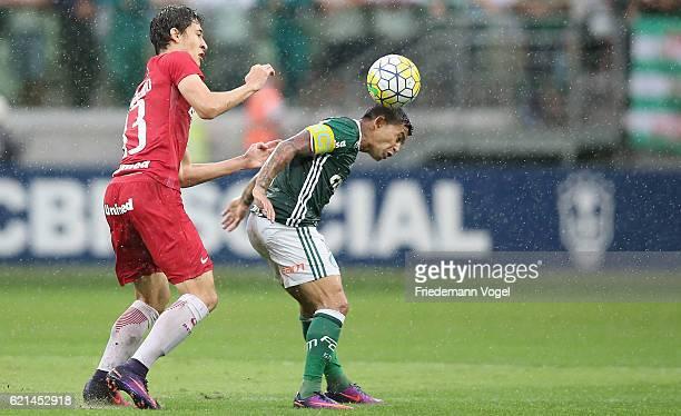 Dudu of Palmeiras fights for the ball with Rodrigo Dourado of Internacional during the match between Palmeiras and Internacional for the Brazilian...