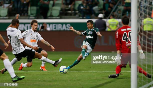 Dudu of Palmeiras kicks the ball to score the first goal of his team during a match between Palmeiras and Atletico MG for the Brasileirao Series A...
