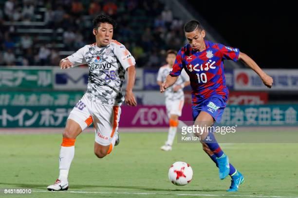Dudu of Ventforet Kofu and Hiroshi Futami of Shimizu SPulse compete for the ball during the JLeague J1 match between Ventforet Kofu and Shimizu...