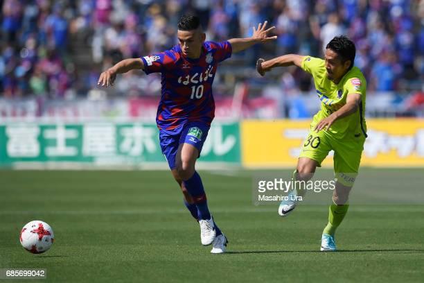 Dudu of Ventforet Kofu and Kosei Shibasaki of Sanfrecce Hiroshima compete for the ball during the JLeague J1 match between Ventforet Kofu and...