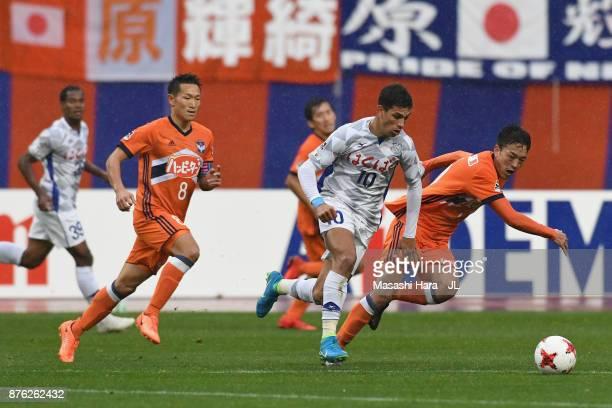 Dudu of Ventforet Kofu and Ryota Isomura of Albirex Niigata compete for the ball during the JLeague J1 match between Albirex Niigata and Ventforet...