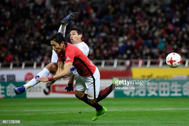 Dudu of Ventforet Kofu and Ryota Moriwaki of Urawa Red Diamonds compete for the ball during the J.League J1 match between Urawa Red Diamonds and...