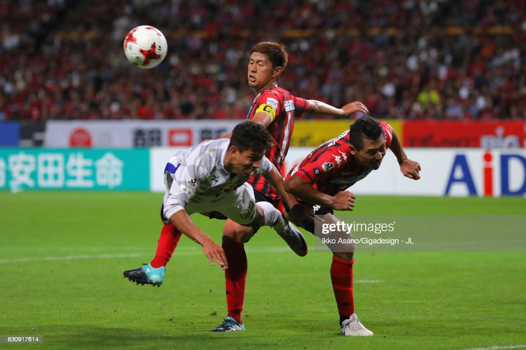 Dudu of Ventforet Kofu and Ryuji Kawai of Consadole Sapporo compete for the ball during the J.League J1 match between Consadole Sapporo and Ventforet Kofu at Sapporo Dome on August 13, 2017 in Sapporo, Hokkaido, Japan.