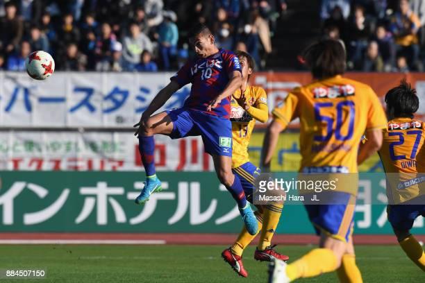 Dudu of Ventforet Kofu and Yasuhiro Hiraoka of Vegalta Sendai compete for the ball during the JLeague J1 match between Ventforet Kofu and Vegalta...