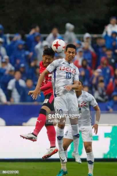 Dudu of Ventforet Kofu and Yusuke Tanaka of Cerezo Osaka compete for the ball during the JLeague J1 match between Cerezo Osaka and Ventforet Kofu at...