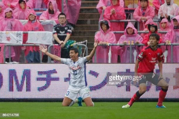 Dudu of Ventforet Kofu appeals to referee after tackled by Yasuki Kimoto of Cerezo Osaka during the JLeague J1 match between Cerezo Osaka and...