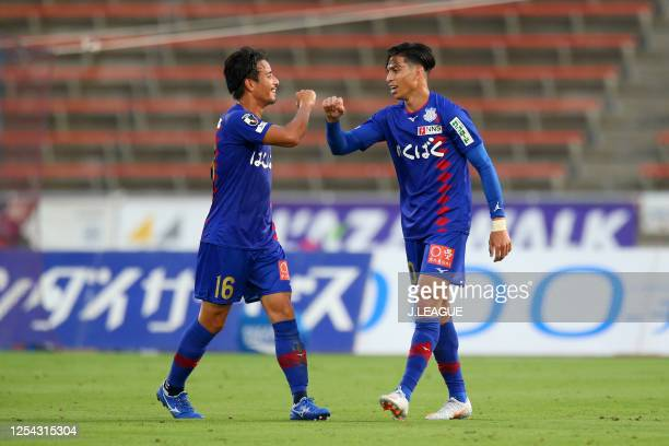 Dudu of Ventforet Kofu celebrates scoring his side's first goal with his team mate Riki Matsuda during the J.League Meiji Yasuda J2 match between...