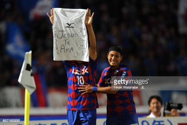 Dudu of Ventforet Kofu celebrates scoring his side's second goal with his team mate Yusuke Tanaka during the J.League J1 match between Ventforet Kofu...