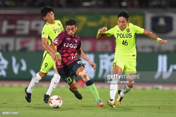 Dudu of Ventforet Kofu competes for the ball against Yuki Muto and Ryota Moriwaki of Urawa Red Diamonds during the JLeague J1 match between Ventforet...