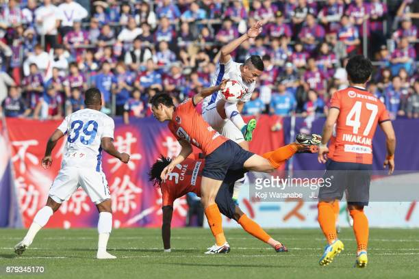 Dudu of Ventforet Kofu controls the ball under pressure of Caue a nd Kohei Yamakoshi of Omiya Ardija during the JLeague J1 match between Omiya Ardija...