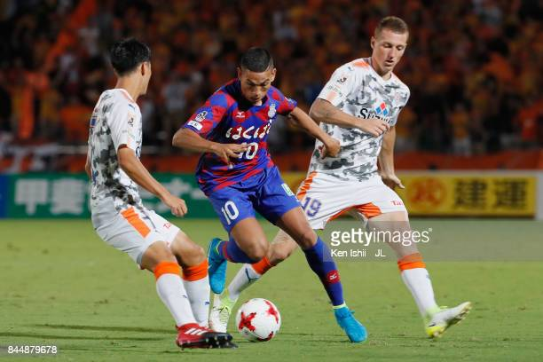 Dudu of Ventforet Kofu controls the ball under pressure of Mitsunari Musaka and Mitchell Duke of Shimizu SPulse during the JLeague J1 match between...