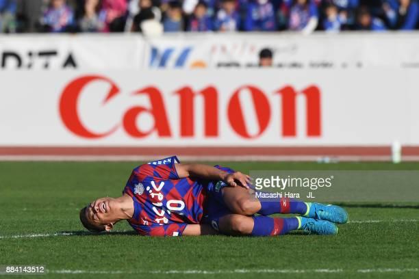 Dudu of Ventforet Kofu lies injured during the JLeague J1 match between Ventforet Kofu and Vegalta Sendai at Yamanashi Chou Bank Stadium on December...
