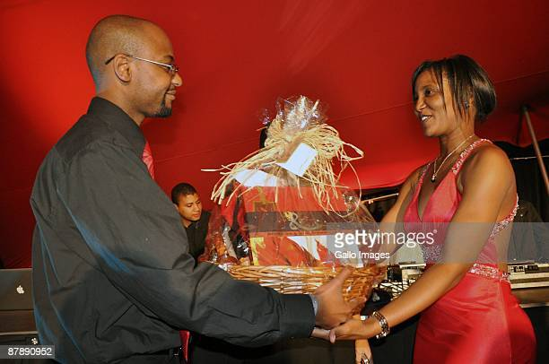 Dudu Zuma being handed a gift from Somizi Mhloto as they celebrate Dudu's 27th Birthday at the upmarket Inanda Club on 19 May 2009 in Sandton South...