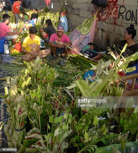 Due to a schedule for tomorrow's Palm Sunday for the first day of the coming Holy Week in the country the group of palm makers rush their merchandise...