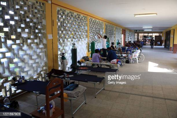 Due to high demand, patients remains in cots in the corridors of Loreto Regional Hospital Felipe Santiago Arriola Iglesias during COVID-19 pandemic...
