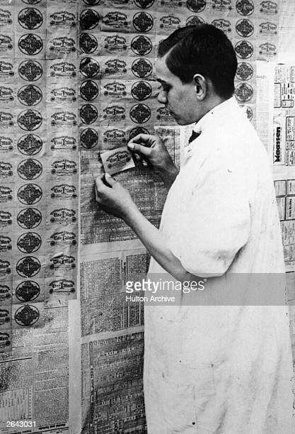 Due to incredible postwar inflation in Germany this man finds if cheaper to paper his walls with paper currency than wallpaper since one roll of the...