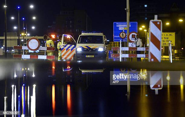 Due to security measures, police block the N14 provincial road in Leidschendam, The Netherlands, on March 24, 2014. World leaders gather in The Hague...