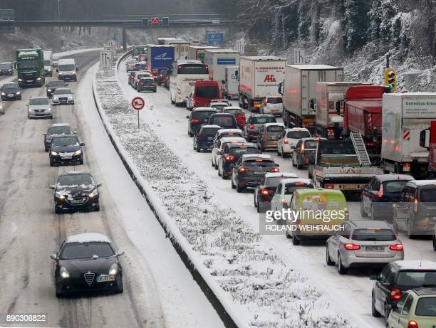 Due to snow traffic jams on the highway A40 near Muehlheim western Germany on December 11 2017 / AFP PHOTO / dpa / Roland Weihrauch / Germany OUT