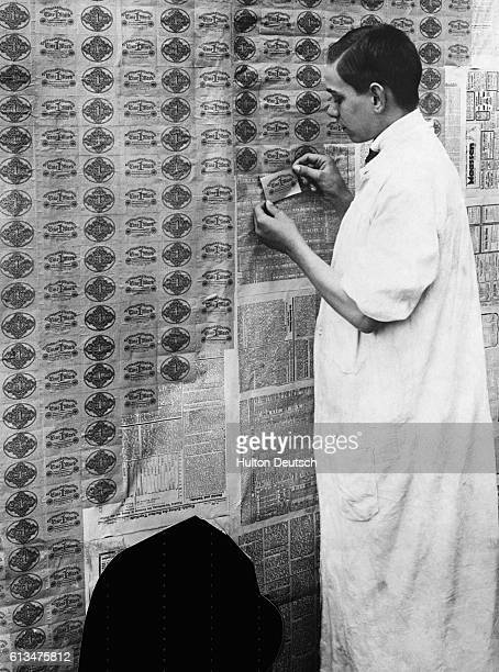 Due to the collapse of German currency it is cheaper to paper a wall with Deutsche marks than it is to buy wallpaper