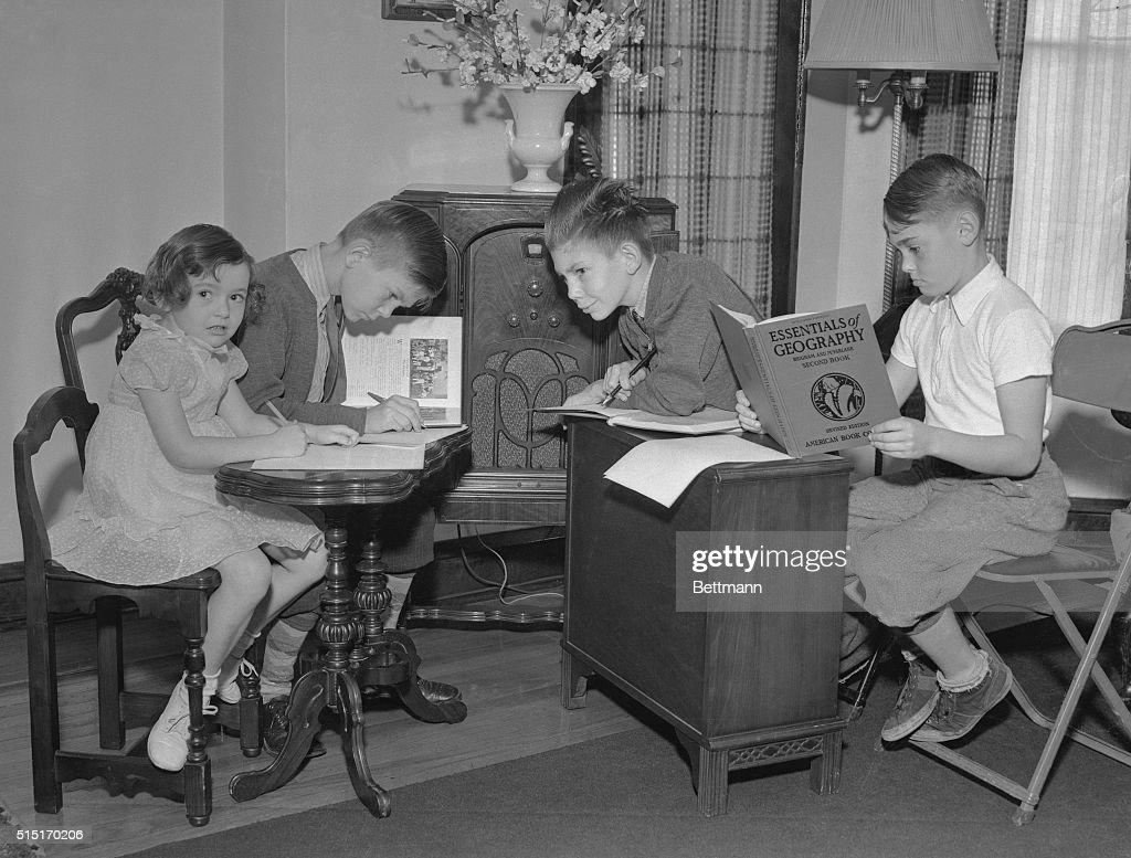Children Listening to School Lessons on Radio : News Photo
