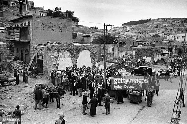 Due to the partitioning of former Palestine into Arab and Israeli areas crowds of Arab refugees crowd Amman streets in 1949