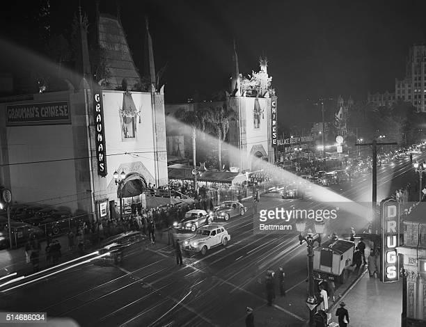 Due to war restrictions, only two searchlights illuminate Grauman's Chinese Theater for the 1943 Academy Awards.